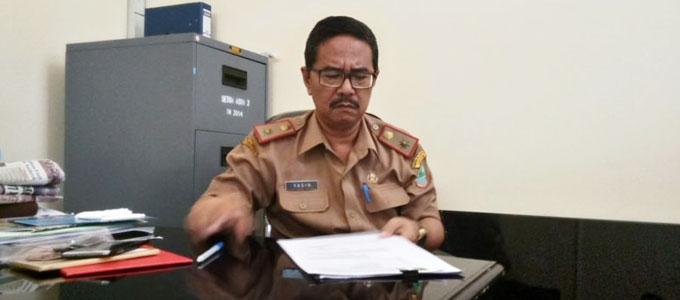 Yasin, Kepala Dinas Komunikasi dan Informasi (Diskominfo) Kabupaten Karawang - baskomnews.com